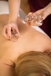 Close-up of woman relaxing during cupping massage